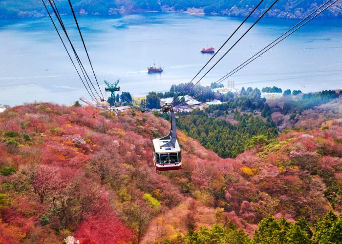 Mt. Komagatake Ropeway during autumn, with fall foliage and blue sky in the background